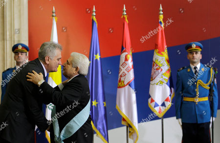 """Cypriot President Dimitris Christofias, center, receives the """"Order of Serbia with a ribbon"""" medal from his Serbian counterpart President Tomislav Nikolic, in Belgrade, Serbia, . Christofias arrived on a one-day official visit to Serbia"""