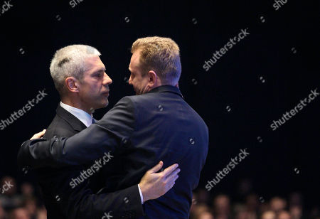 Former Serbian President and former Democratic Party leader Boris Tadic, left, congratulates to newly elected President Dragan Djilas during a party congress in Belgrade, Serbia, . Serbia's biggest opposition party, the pro-Western Democrats, have elected Belgrade's popular mayor Dragan Djilas as the new party leader. Tadic stepped down from the party helm after he and the party lost general elections earlier this year to the nationalists, former loyalists of Serbia's late strongman Slobodan Milosevic