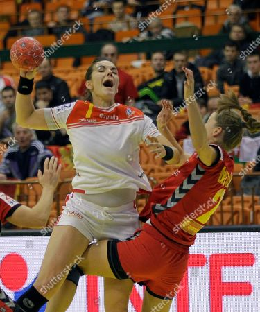 Beatriz Fernandez Ibanez of Spain, left, challenges for the ball with Radmila Miljanic of Montenegro during their women's handball European Championship Group II main round match between Spain and Montenegro, in Novi Sad, Serbia
