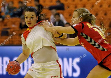Beatriz Fernandez Ibanez of Spain, left, and Andrea Klikovac of Montenegro challenge for the ball during their women's handball European Championship Group II main round match between Spain and Montenegro, in Novi Sad, Serbia