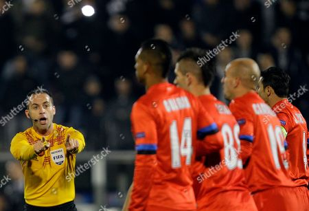 Stock Picture of Referee Duarte Gomes gestures during the UEFA Europa League Group H soccer match between FK Partizan Belgrade and Inter Milan, in Belgrade, Serbia
