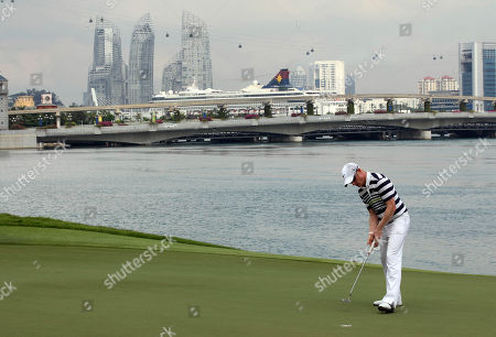 Simon Dyson Simon Dyson of Britain putts on the fourteenth green during the third round of the Singapore Open golf tournament at the Serapong Course at Sentosa Golf Club in Singapore on