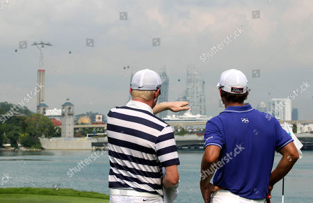 Adam Scott, Simon Dyson Adam Scott of Australia, right, and Simon Dyson of Britain admire the view of the city during the third round of the Singapore Open golf tournament at the Serapong Course at Sentosa Golf Club in Singapore on