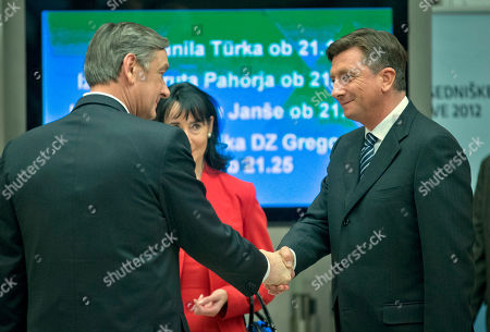 Borut Pahor, Daniko Turk President elect, Slovenia's former prime minister Borut Pahor, right, shakes hands with outgoing president Danilo Turk, in Ljubljana, Slovenia, . Pahor, who has called for unity in the tiny EU nation amid growing discontent with government tax hikes and spending cuts, won the presidential election