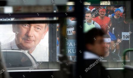 Electoral posters of president incumbent, Danilo Turk, left and former prime minister Borut Pahor are seen through a bus window in Ljubljana, Slovenia, . Runoff for presidential elections will be held on Sunday, Dec. 2, 2012