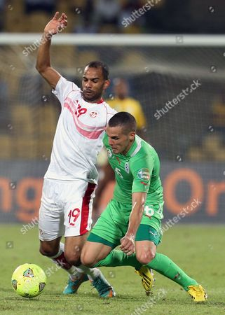 Algeria's Djamel Mesbah, right, defends against Tunisia's Saber Khalifa, left, during their African Cup of Nations Group D soccer match at Royal Bafokeng Stadium in Rustenburg, South Africa