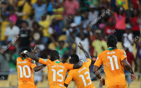 Ivory Coast's Ya Konan, second from right, celebrates with teammates after scoring a goal during their African Cup of Nations Group D soccer match against Tunisia at the Royal Bafokeng Stadium in Rustenburg, South Africa