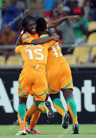 Ivory Coast's Gervinho, left, celebrates with teammates after Ya Konan, right, scored a goal during their African Cup of Nations Group D soccer match against Tunisia at the Royal Bafokeng Stadium in Rustenburg, South Africa