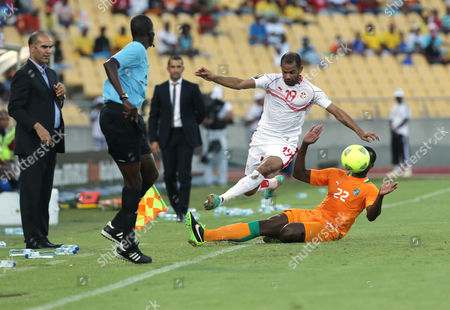 Tunisia's Saber Khalifa, top, is challenged by Ivory Coast's Souleman Bamba, bottom, during their African Cup of Nations Group D soccer match at the Royal Bafokeng Stadium in Rustenburg, South Africa