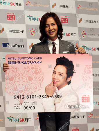 Stock Picture of Jang Keun-suk South Korean actor Jang Keun-suk poses with a giant pre-paid card during a publicity event to introduce the card that mainly targets Japanese people coming to South Korea in Seoul, South Korea, . The card is issued by Japan's Mitsui Sumitomo Card Co. and approved by South Korea's Hana SK Card Co