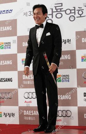 Ahn Sung-ki South Korean actor Ahn Sung-ki poses for photographers during the Blue Dragon Awards in Seoul, South Korea, . The award is a major film and art awards ceremony in South Korea
