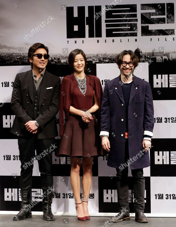 """Gianna Jun, Ryu Seung-beom, Ha Jung-woo South Korean actress Gianna Jun, center, poses with actors Ryu Seung-beom, right, and Ha Jung-woo for photographers during a press conference promoting their new film """"The Berlin File"""" in Seoul, South Korea, . The movie is to be released in the country on Jan. 31"""