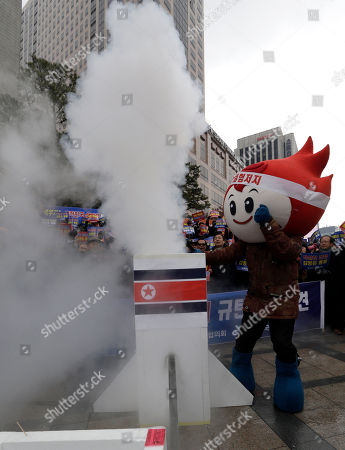 Anti-North Korea protester performs with a mock North Korea rocket during a rally denouncing North Korea's possible third round of nuclear test in Seoul, South Korea, . U.S. Secretary of State John Kerry and his South Korean Foreign Minister Kim Sung-hwan have agreed to make sure North Korea is punished if it carries out its threat to conduct a nuclear test