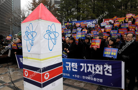 """Anti-North Korea protesters shout slogans during a rally denouncing North Korea's possible third round of nuclear test in Seoul, South Korea, . U.S. Secretary of State John Kerry and his South Korean Foreign Minister Kim Sung-hwan have agreed to make sure North Korea is punished if it carries out its threat to conduct a nuclear test. The letters on the banners """"North Korean nuclear tests are the disasters of humankind and that the collapse of the Kim Jong Un regime is the peace of the Korean peninsula"""