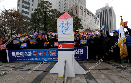 """Anti-North Korea protesters shout slogans during a rally denouncing North Korea's possible third round of nuclear test in Seoul, South Korea, . New U.S. Secretary of State John Kerry and his South Korean Foreign Minister Kim Sung-hwan have agreed to make sure North Korea is punished if it carries out its threat to conduct a nuclear test. The letters on the banners read """"North Korean nuclear tests are the disasters of humankind and that the collapse of the Kim Jong Un regime is the peace of the Korean peninsula"""