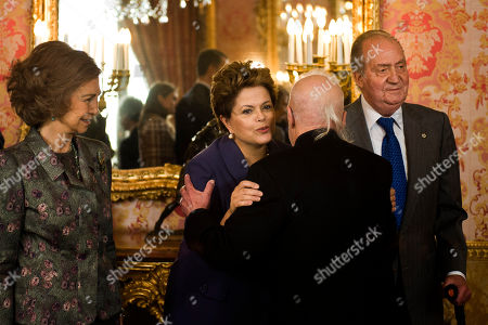 King Juan Carlos, Dilma Rousseff, Paulo Coelho, Queen Sofia Brazil's President Dilma Rousseff, center left, welcomes writer Paulo Coelho, flanked by Spain's King Juan Carlos, right, and Queen Sofia before a lunch at the Royal Palace, in Madrid