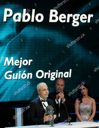 """Pablo Berger Spanish director Pablo Berger, left, speaks while accepting the best original screenplay award for his film """"Blancanieves"""" during the annual Goya film awards in Madrid, Spain"""
