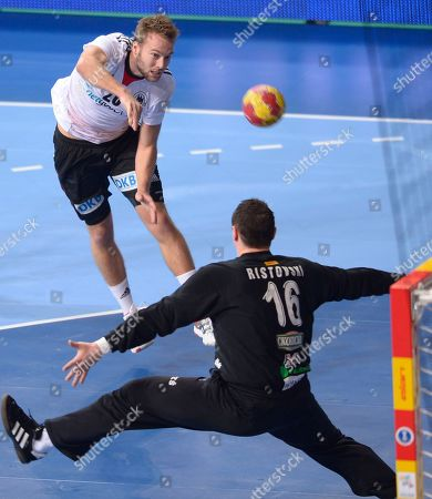 Stock Picture of Kevin Schmidt, Borko Ristovski Germany's Kevin Schmidt, left, leaps in the air to score past Macedonia's goalkeeper Borko Ristovski during the 23rd Men's Handball World Championships round of 16 match at the Palau Sant Jordi in Barcelona, Spain