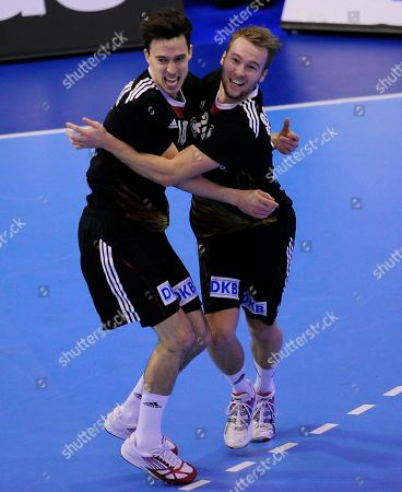 Stock Photo of Kevin Schmidt, Patrick Groetzki Germany's Kevin Schmidt, right, and Patrick Groetzki celebrate during a preliminary round Group A Men's World Handball championship match against Argentina in Granollers, Spain
