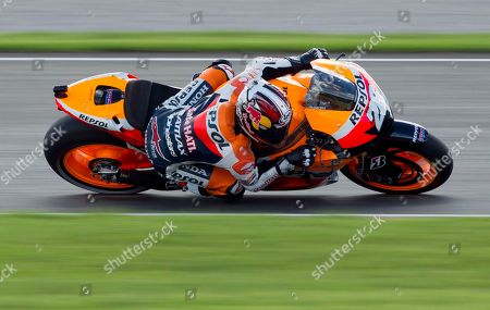 Dani Pedrosa MotoGP Repsol Honda Team rider Dani Pedrosa from Spain rides his motorbike during the qualifying practice session for Sunday's Motorcycle Grand Prix at the Ricardo Tormo circuit in Cheste near Valencia, Spain, . Dani Pedrosa gets the Pole Position with Jorge Lorenzo second and Casey Stoner third.The last race of the season takes place Sunday