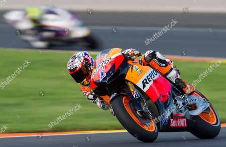 Casey Stoner MotoGP Repsol Honda Team rider Casey Stoner, from Australia, rides his motorbike during the qualifying practice session for Sunday's Motorcycle Grand Prix at the Ricardo Tormo circuit in Cheste near Valencia, Spain, . Dani Pedrosa took pole position with Jorge Lorenzo second and Casey Stoner third.The last race of the season takes place Sunday