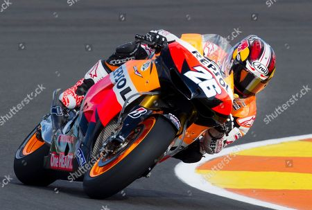 Dani Pedrosa MotoGP Repsol Honda Team rider Dani Pedrosa from Spain rides his motorbike during the qualifying practice session for Sunday's Motorcycle Grand Prix at the Ricardo Tormo circuit in Cheste near Valencia, Spain, . Dani Pedrosa won the pole position with Jorge Lorenzo second and Casey Stoner third. The last race of the season takes place Sunday