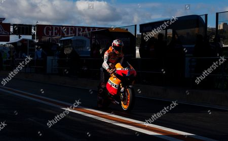 Casey Stoner MotoGP Repsol Honda Team rider Casey Stoner, from Australia, rides in the pit during the third free practice for Sunday's Motorcycle Grand Prix at the Ricardo Tormo circuit in Cheste near Valencia, Spain, . The last race of the season takes place Sunday