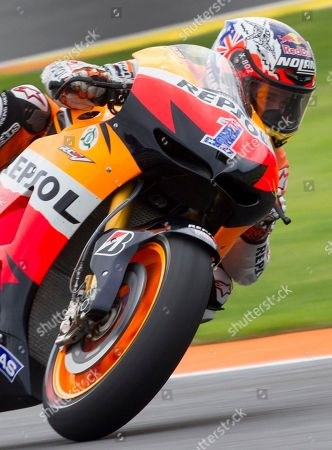 Casey Stoner MotoGP Repsol Honda Team rider Casey Stoner rides during the Motorcycle Grand Prix at the Ricardo Tormo circuit in Cheste near Valencia, Spain, . The Australian rider is retiring at 27 after winning the MotoGP title with Ducati in 2007 and his current Honda team in 2011. He won 38 MotoGP races since joining the circuit full-time in 2006