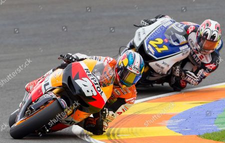 Dani Pedrosa, Katsuyuki Nakasuga MotoGP Repsol Honda Team rider Dani Pedrosa from Spain, left, leads Yamaha Team Katsuyuki Nakasuga, from Japan, right, during the Motorcycle Grand Prix at the Ricardo Tormo circuit in Cheste near Valencia, Spain, . Dani Pedrosa won the season-ending Valencia Grand Prix after starting from the pit lane and taking advantage of world champion Jorge Lorenzo's crash on Sunday. Katsuyuki Nakasuga was second on his Yamaha, more than 37 seconds behind, while retiring two-time world champion Casey Stoner earned his 69th career MotoGP podium with a third-place finish in his final race