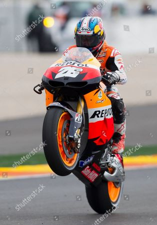 Dani Pedrosa MotoGP rider Dani Pedrosa makes a wheelie as he celebrates his victory at the end of the Motorcycle Grand Prix at the Ricardo Tormo circuit in Cheste near Valencia, Spain, . Dani Pedrosa won the season-ending Valencia Grand Prix after starting from the pit lane and taking advantage of world champion Jorge Lorenzo's crash on Sunday. Katsuyuki Nakasuga was second on his Yamaha, more than 37 seconds behind, while retiring two-time world champion Casey Stoner earned his 69th career MotoGP podium with a third-place finish in his final race