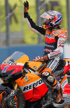 Casey Stoner MotoGP Repsol Honda Team rider Casey Stoner salutes at the Motorcycle Grand Prix at the Ricardo Tormo circuit in Cheste near Valencia, Spain, . The Australian rider is retiring at 27 after winning the MotoGP title with Ducati in 2007 and his current Honda team in 2011. He won 38 MotoGP races since joining the circuit full-time in 2006