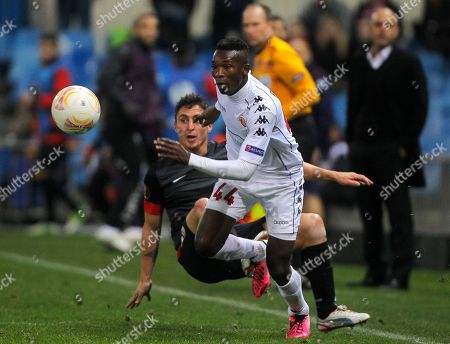 John Pantsil, Cristian Rodriguez Atletico de Madrid's Cristian Rodriguez from Uruguay, left, in action with Hapoel Tel Aviv's John Pantsil from Ganha, right, during a Europa League Group B soccer match at the Vicente Calderon stadium in Madrid, Spain