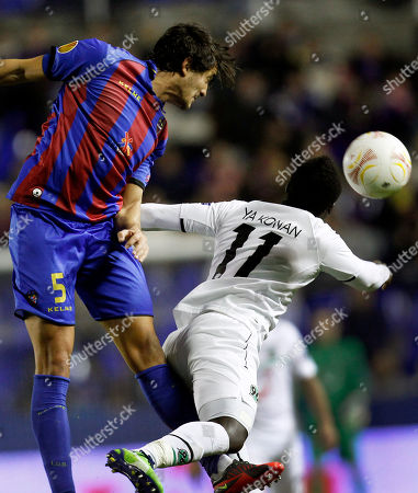 Hector Rodas, Didier Ya Konan Hannover's Didier Ya Konan from Ivory Coast heads the ball with Levante's Hector Rodas, left, during their Europa League Group L soccer match at the Ciutat de Valencia stadium in Valencia, Spain