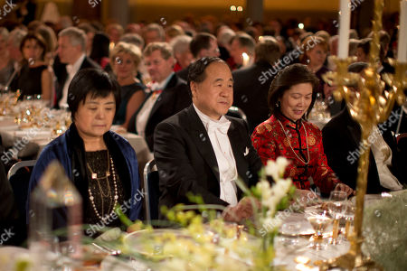 The 2012 Nobel Prize Laureate for Literature China's Mo Yan, center, sits beside his wife Du Qinlan Du, left, during the 2012 Nobel Prize Banquet at the Town Hall in Stockholm