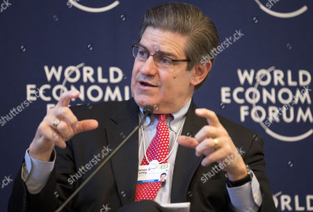 Stock Picture of James S. Turley from the U.S., Chairman and Chief Executive Officer of Ernst and Young gestures during the G 20 outlook session at the 43rd Annual Meeting of the World Economic Forum, WEF, in Davos, Switzerland