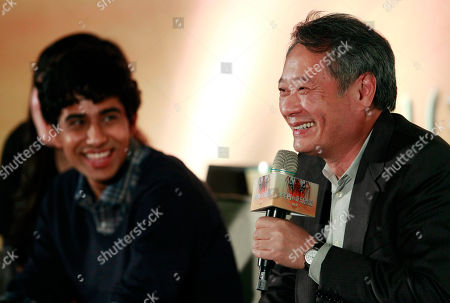 """Suraj Sharma, Ang Lee Lead actor from India Suraj Sharma, left, looks, as Taiwanese director Ang Lee answers questions during a press conference announcing their new film """"Life of Pi,"""" in Taipei, Taiwan, . """"Life of Pi"""" is an upcoming 3D adventure film based on the 2001 novel of the same name by Yann Martel, staring Sharma and directed by Lee"""