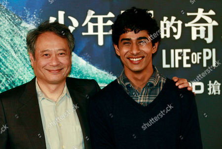 """Stock Image of Suraj Sharma, Ang Lee Taiwanese director Ang Lee, left, and lead actor from India Suraj Sharma pose for media during a press conference announcing their new film """"Life of Pi,"""" in Taipei, Taiwan, . """"Life of Pi"""" is an upcoming 3D adventure film based on the 2001 novel of the same name by Yann Martel, staring Sharma and directed by Lee"""