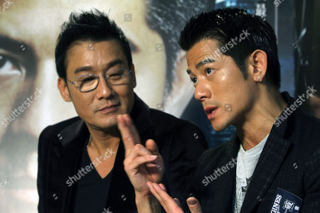 "Aaron Kwok, Tony Leung Ka Fai On, Hong Kong actor Aaron Kwok, right, speaks while Tony Leung Ka Fai listens during an interview for their new film ""Cold War"" in Taipei, Taiwan"