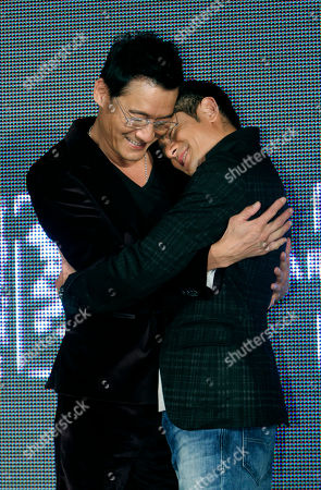 """Aaron Kwok Tony Leung Ka Fai On, Hong Kong actors Aaron Kwok, right, and Tony Leung Ka Fai pose for the media during a promotional event for their new film """"Cold War"""" in Taipei, Taiwan"""
