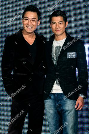 """Aaron Kwok, Tony Leung Ka Fai On, Hong Kong actors Aaron Kwok, right, and Tony Leung Ka Fai pose for the media during a promotional event for their new film """"Cold War"""" in Taipei, Taiwan"""
