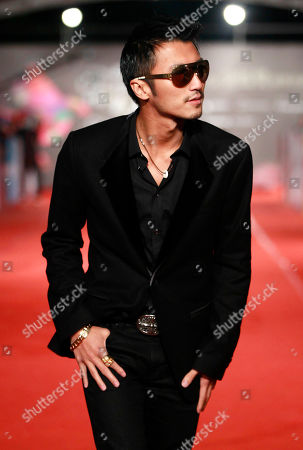 """Nicholas Tse Hong Kong actor Nicholas Tse smiles as he arrives at the 49th Golden Horse Awards at the Luodong Cultural Working House in Yilan County, Taiwan, . Tse is nominated as Best Leading Actor for the film """"The Viral Factor"""" at this year's Golden Horse Awards, one of the Chinese-language film industry's biggest annual events"""