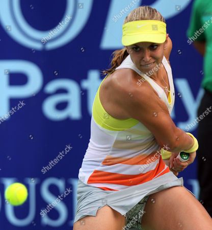 Sabine Lisicki of Germany concentrates on a ball before returning a shot against Nina Bratchikova of Russia during their semifinal tennis match at the Pattaya Open tennis in Pattaya, Thailand