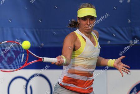 Sabine Lisicki of Germany returns a shot against Nina Bratchikova of Russia during their semifinal tennis match at the Pattaya Open tennis in Pattaya, Thailand