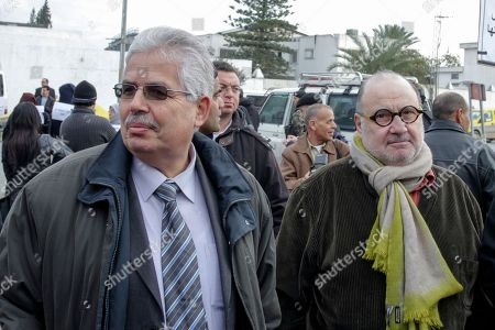 Dean at the Tunis university, Habib Kazdaghli, left, arrives at the Tunis court house to appear before a court, on charges of allegedly assaulting a veiled student. French TV director Serge Moati, right, came to the court to support Kazdaghli. A young Salafi student filed a lawsuit against Habib Kazdaghli claiming he assaulted her in his office, and Kazdaghli has denied the allegation, saying he was only defending himself against an agitated student who burst into his office uninvited