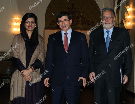 Hina Rabbani Khar, Ahmet Davutoglu, Zalmai Rassoul From left to right, Foreign ministers Hina Rabbani Khar of Pakistan, Ahmet Davutoglu of Turkey and Zalmai Rassoul of Afghanistan pose for cameras before their meeting in Ankara, Turkey, . Presidents of their countries, Asif Ali Zardari, Hamid Karzai and Abdullah Gul will attend Wednesday the 7th Trilateral Summit of Afghanistan, Pakistan and Turkey