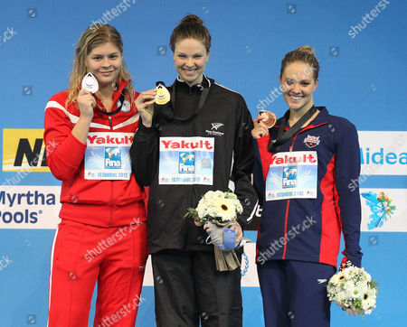 Lauren Boyle, Lotte Friis, Chloe Sutton Gold medalist Lauren Boyle of New Zealand, center, silver medalist Lotte Friis of Denmark, left, and bronze medalist Chloe Sutton of U.S. pose for the photographers during the women's 800 meters freestyle awards ceremony of the FINA Short Course Swimming World Championships at the Sinan Erdem Arena in Istanbul