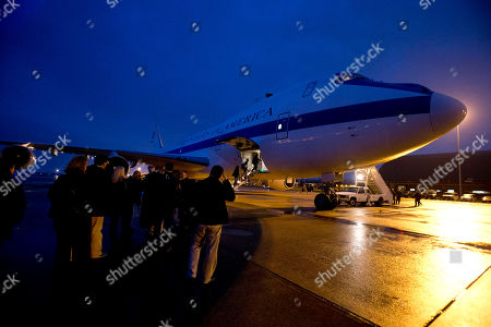 The E-4B plane is loaded at dawn in preparation for the arrival of U.S. Defense Secretary Leon Panetta, en route to Portugal, on what is expected to be his last trip overseas, at Andrews Air Force Base, Md on