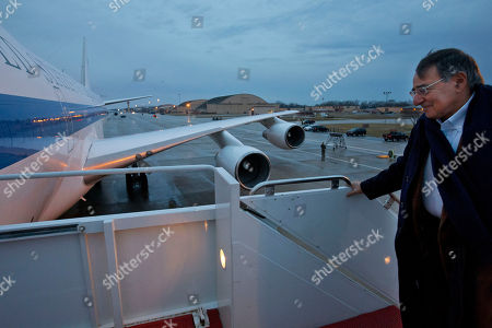 U.S. Defense Secretary Leon Panetta boards the E-4B plane en route to Portugal, expected to be his last trip overseas, at Andrews Air Force Base, Md on