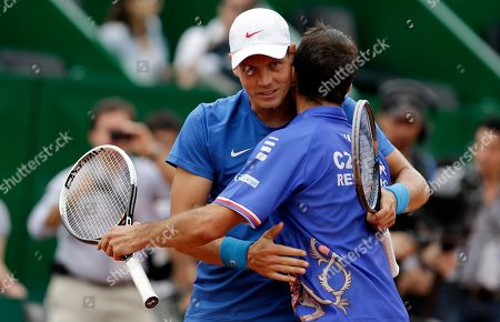 Czech Republic's Tomas Berdych, left, and Radek Stepanek embrace after winning their doubles match 6-3, 6-4, 6-3, against Argentina's Eduardo Schwank and Carlos Berlocq, in a Davis Cup tennis semifinals in Buenos Aires, Argentina