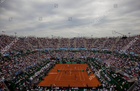 Czech Republic's Tomas Berdych and Radek Stepanek, in blue shirts, and Argentina's Eduardo Schwank and Carlos Berlocq compete in their doubles match of the Davis Cup tennis semifinals in Buenos Aires, Argentina